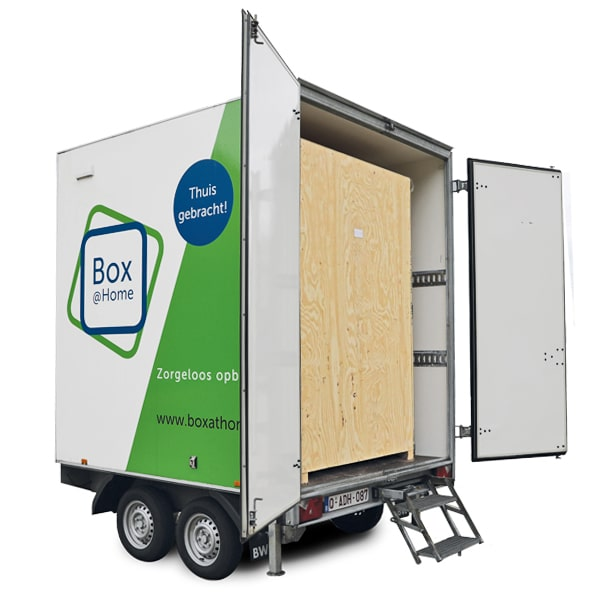 A Medium Box from Box@Home on a trailer with open doors and closed wooden inner box